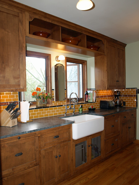 kitchen with custom tile and sink