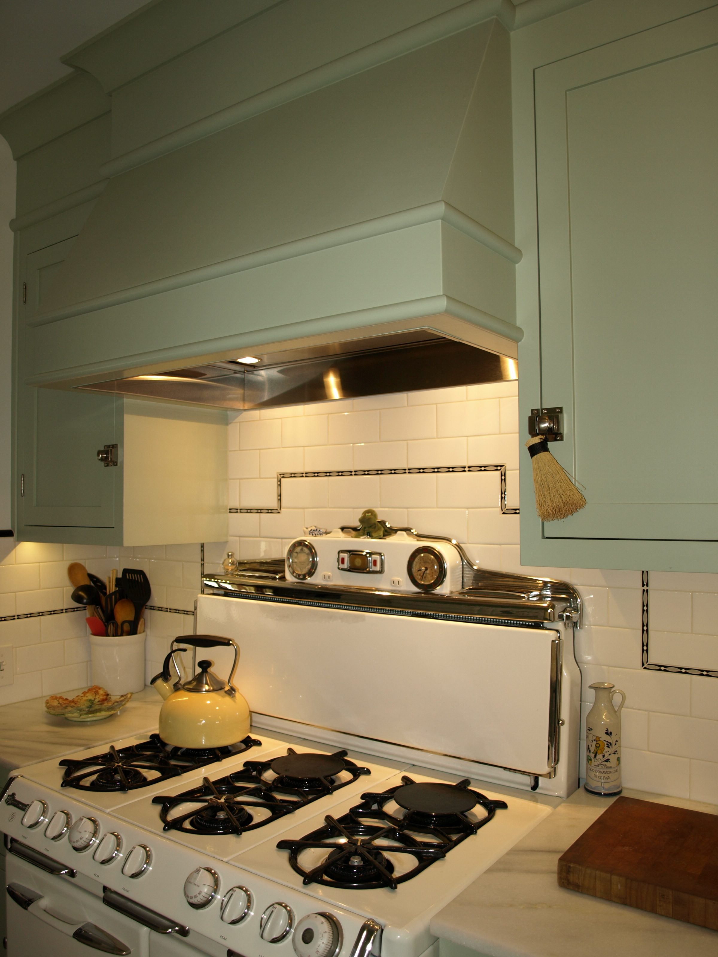 "Vintage O'Keefe & Merritt range, custom ""fish"" deco liner, subway tile, custom cabinets"